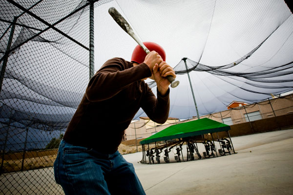 taking a swing at the batting cage
